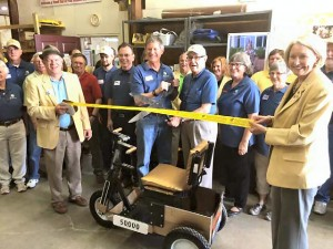 Gary and Mel at center with scissors. Barbara Moran, at right of them, is a volunteer with their shop and board secretary for PET Int'l. She is helping to spearhead the celebration and provided details of the kickoff event.